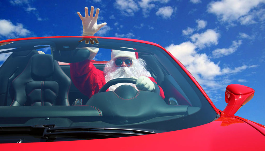 Santa Claus. Santa Drives fast in his Red Sports Car with a Blue